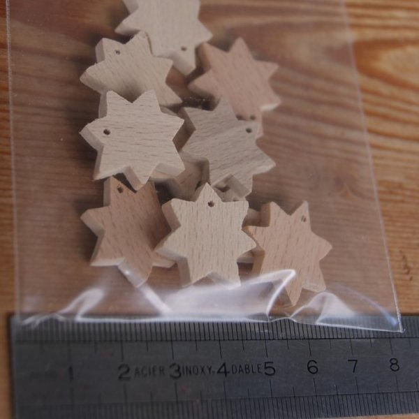 Figurine miniature etoiles a 7 branches percées, decoration de Noel a decorer et suspendre